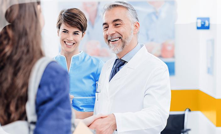 Happy patient shaking doctor's hand